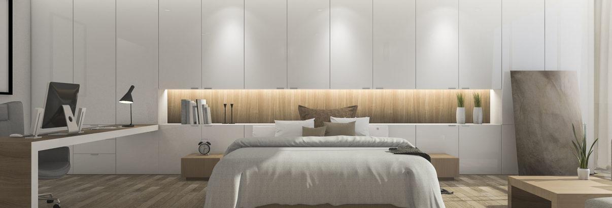 Chambre avec tête de lit avec rangement, recouvrant un pan de mur