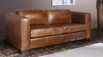 canapé convertible en cuir marron dans un salon